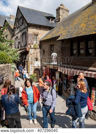 Le Mont-saint-michel, France - September 13, 2018: A Crowd Of Tourists On Grand Rue, The Main Street