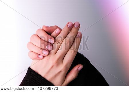 Closeup Top View Horizontal Photography Of Elegant Pastel Pink Natural Manicure. Female Hands. Gel N