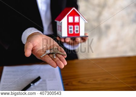 Keys And Red Roof Houses In The Hands Of A Business, Ideas For Real Estate Investors, Mortgages, Ren