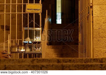 Three Menorahs Are Lit At The Entrance To A Building In The Jewish Quarter Of The Old City Of Jerusa