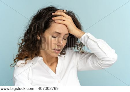 Studio Portrait Of Tired Frustrated Business Woman Or Office Worker Touching Her Forehead, Has Emoti