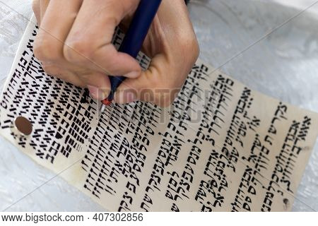 A Writer's Hand Practices Decorating Letters From A Torah Scroll Written On Parchment In Hebrew, (fo