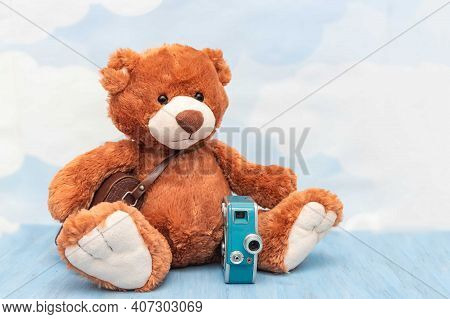 Close-up Of Cute Plush Teddy Bear Toy On Pastel Sky Background. Stuffed Toy With Old Vintage Photoca