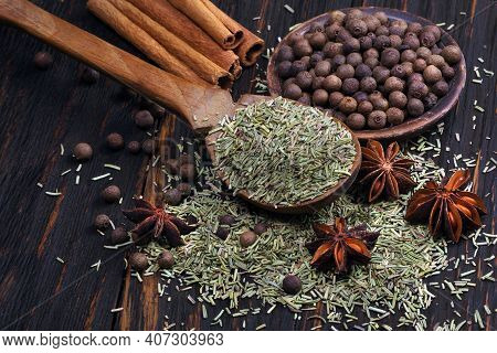 Traditional Spices. Rosemary, Allspice, Cinnamon And Anise On A Wooden Table