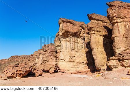Solomon pillars of Timna park. Israel. Hot November day. The Timna Valley in the south of the Arava Desert, near the resort of Eilat. Magnificent sandstone rocks.