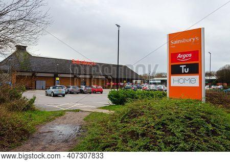 Flint; Uk: Jan 28, 2021: Signage Beside A Sainsbury's Supermarket Shows Some Of The Instore Brands,