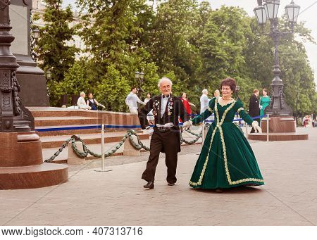 Moscow,russia, May 26,2019: The Elderly Couple In Retro Suits Dancing In The Square. A Man And A Wom