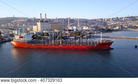 Oil Tanker Ship Loading In Port. Fuel Tanker Ship Docked In Industrial Area. Lpg Tanker.