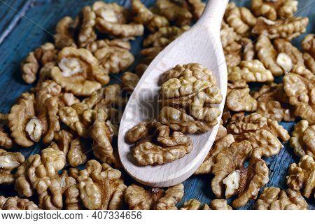 Food Background. Peeled Walnut Close-up. Walnut Kernels Lie On A Wooden Spoon.