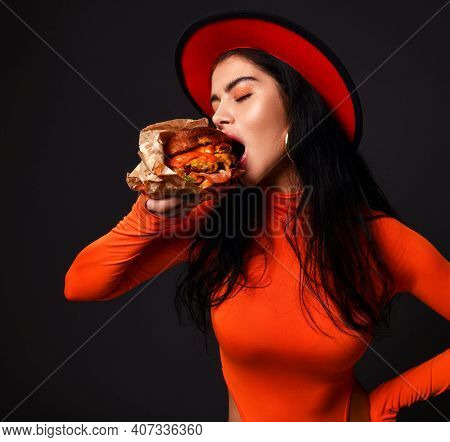Hungry Sexy Curvy Woman With Pouty Lips In Red Body And Hat Is Eating Biting Big Burger Cheeseburger