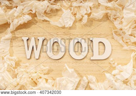 Wooden Word Or Wood Table Ans Wood Shavings. Woodworking, Craftsmanship And Handwork Concept, Flat L