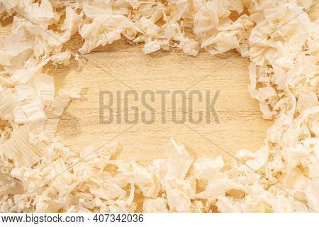 Carpentry Or Woodworking Background With Copy Space. Border Frame Of Wood Shavings On Wood Table. Wo