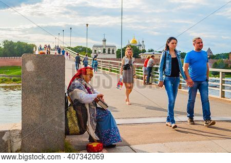 Veliky Novgorod,russia - August 10, 2019. Woman Dressed In Slavic Folk Clothes Is Playing The Gusli,