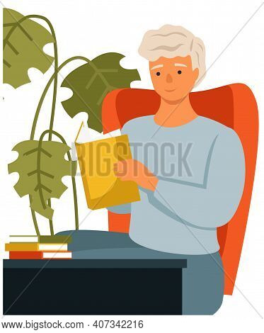 Man Is Reading Book Sitting At A Table At Home. Young Guy Sits In Armchair Isolated On White Backgro