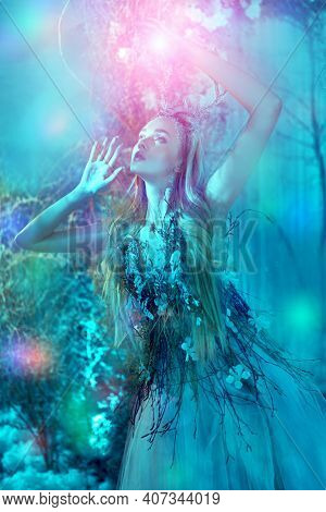Fantasy world. Fabulous forest nymph in a magical winter forest.