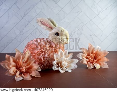 Stuffed Easter Rabbit Bunny Covered In Peach Flowers Sitting On A Terra-cotta Counter With A Herring