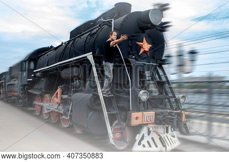 Arrival Of Old Train At The Station. Technique Since Second World War. Retro Locomotive Pulls Up To