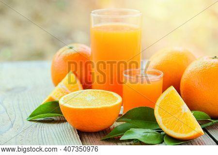Fresh Orange Juice In The Glass With Orange Fruit On Wooden Background, Healthy Fruits And Orange Sl