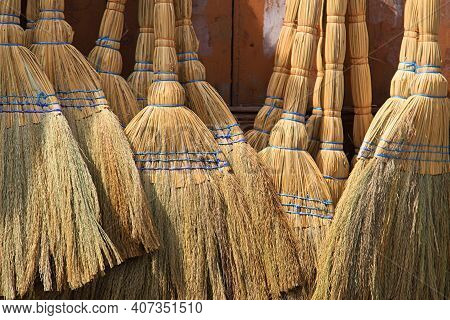 A Background Of Traditional Straw Brooms In The Lebanese Town Of Batroun.