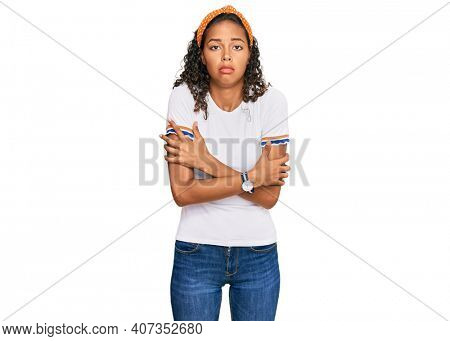 Young african american girl wearing casual clothes shaking and freezing for winter cold with sad and shock expression on face