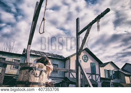 A Woman Cries On The Scaffold In The City Square With A Gallows For Executions