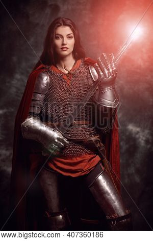 Era of romanticism. Portrait of a beautiful female knight in armor of noble birth. The Middle Ages history.