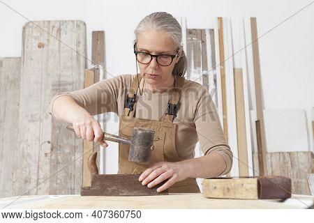 Wood Crafts, Woman Artisan Carpenter Works Wood With Old Handle Planer And Hammer Tools In Her Works