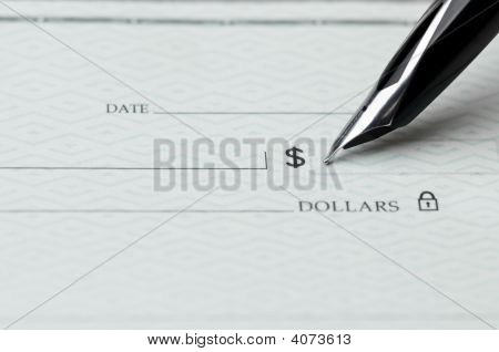 Pen Writing On A Bank Check