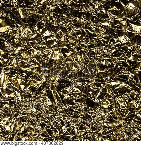 Golden Foil Background With Shiny Crumpled Surface For Texture Background. Iridescent Surface Wrinkl