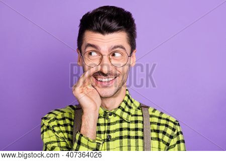 Photo Portrait Of Man Covering Mouth With Hand Telling Secret Isolated On Vivid Violet Colored Backg