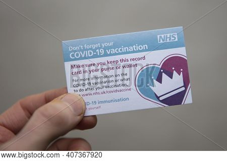 Oxford, Uk - February 2020: A Person Holds An Nhs Covid-19 Vaccination Reminder