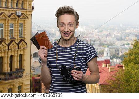 Portrait Of Teen American Traveler In Europe. Boys Holding Passport And Binoculars.