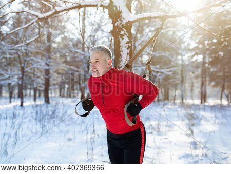 Functional Training. Portrait Of Fit Senior Man In Sportswear Doing Exercises With Fitness Straps At