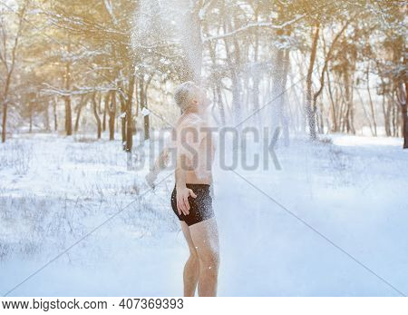 Cold Weather Training And Winter Fun. Mature Man In Underwear Standing Under Falling Snow, Throwing