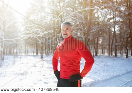 Running Fitness During Winter. Portrait Of Sporty Senior Man Taking Break From His Jogging Workout A