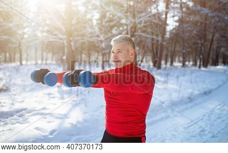 Outdoor Bodybuilding Strength Workout. Senior Man Exercising With Dumbbells, Pumping Up Muscles At S