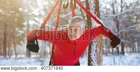 Strong Senior Man Doing Bungee Fitness Exercises, Working Out Outdoors On Winter Morning, Panorama.