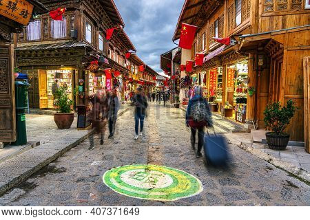 Lijiang, China - October 2019 : Scenic View Of The Dukezong Ancient Old Town With Tourist At Evening