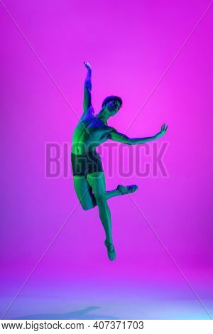 Emotions. Young And Graceful Ballet Dancer On Purple Studio Background In Neon Light. Art, Motion, A