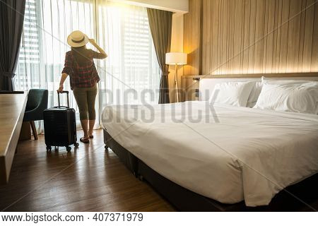 Happiness Asian Traveler Woman Standing With Baggage In Bedroom Of Hotel Or Hostel When Traveling On
