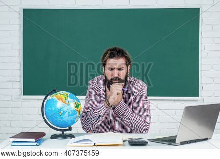 Brutal Bearded Man Work In Classroom Being Ill. Prepare For Exam While Coronavirus Pandemic. College