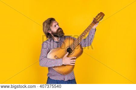 Hipster With Long Hair And Moustache Guitarist. Male Guitarist With Musical Instrument. Country Musi