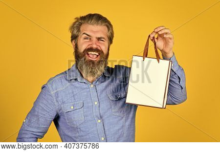 Buy Gift. Bearded Man Hold Shopping Bags. Retail Concept. Happy Holidays. Handsome Buyer. Seasonal S