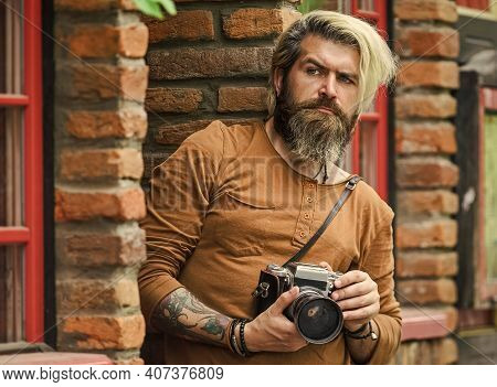 Search For Inspiration. Hipster Man With Beard Use Professional Camera. Photographer Retro Camera. J