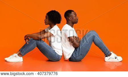 Frustrated Young Black Couple Sitting On Floor Back To Back After Fight, Feeling Lonely And Upset, O