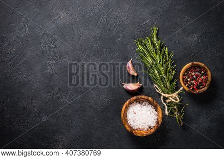 Food Cooking Background On Black. Herbs And On Black Stone Table. Top View With Copy Space.