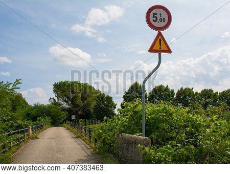 A Warning Sign On A Narrow Rural Bridge In Friuli-venezia Giulia, North East Italy, Indicates That T