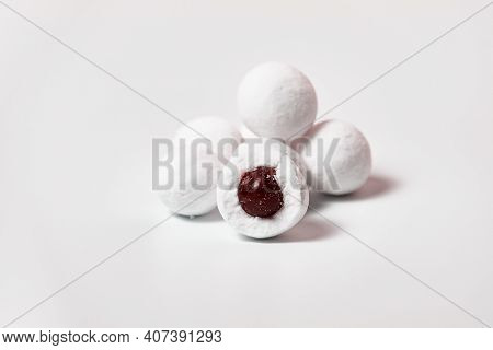 Cranberries In Powdered Sugar On A White Background.
