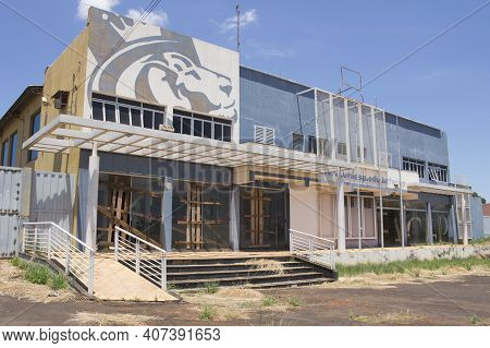 Ibitinga, Sp, Brazil - Feb 09 2021: Facade Of Abandoned College Building With Wood Barricade On The