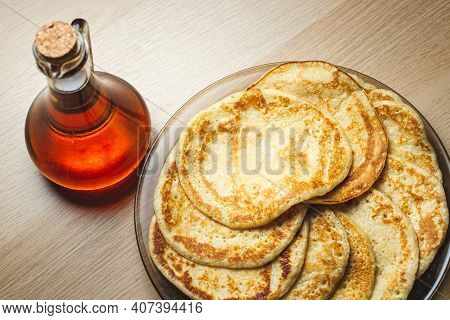 Close Up View Of Pancakes And Maple Sirup On A Table - Homemade Food